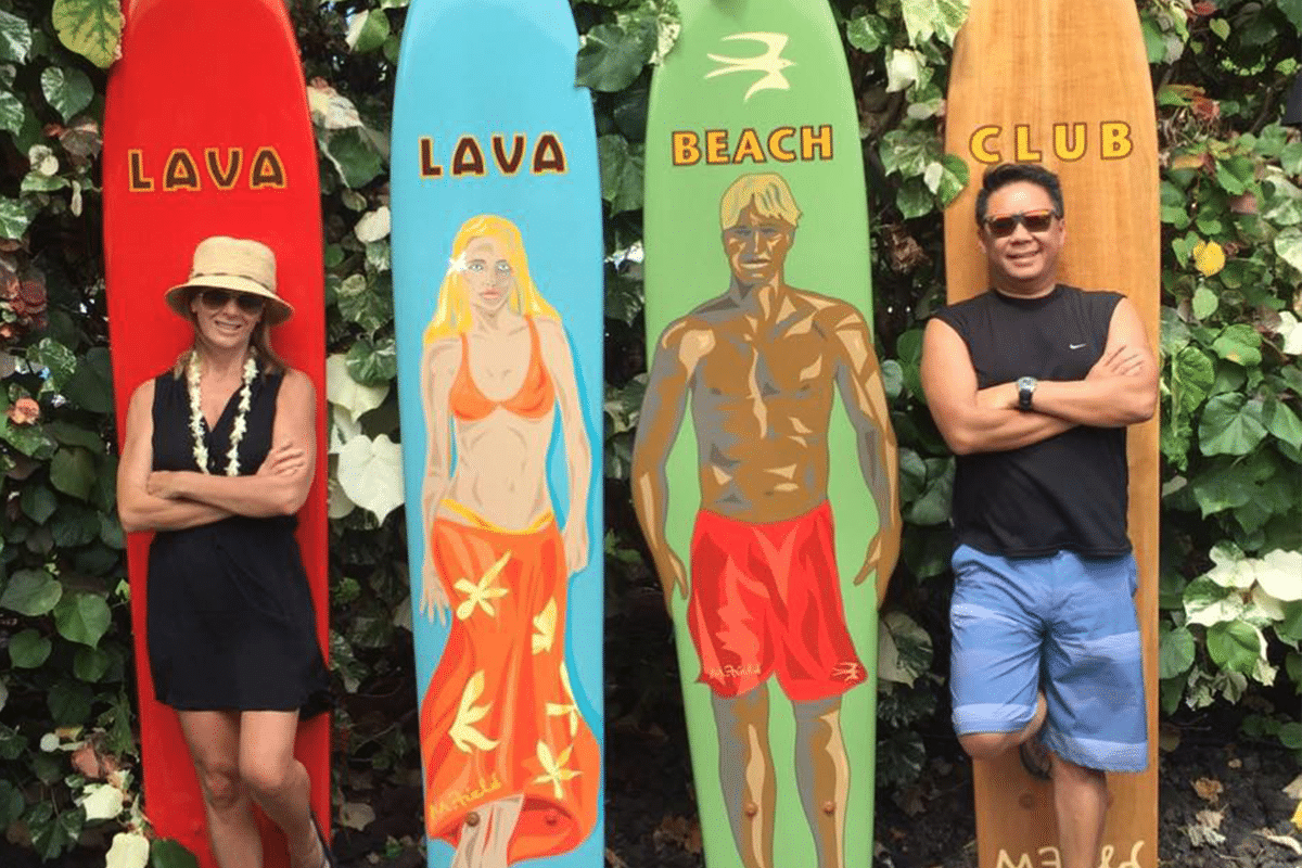 Dan and Sandy Yuen in Front of Surfboard